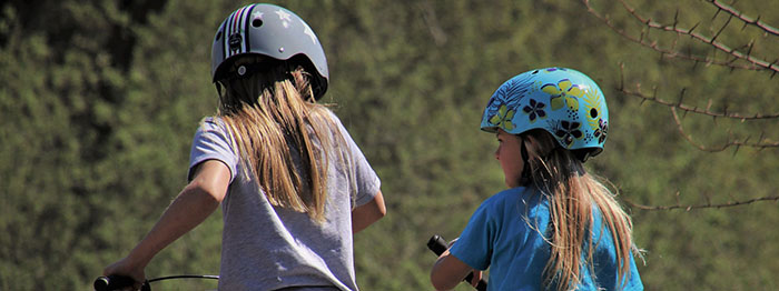 Children wearing helmets while bicycling
