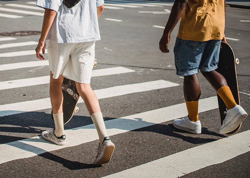 Pedestrians walking over crosswalk